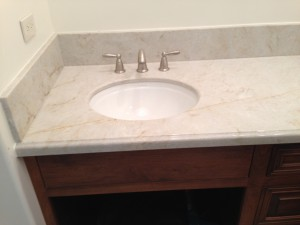 Soapstone Werks loves to work with all natural stone. This bathroom vanity  is made out of the beautiful Quartzite.